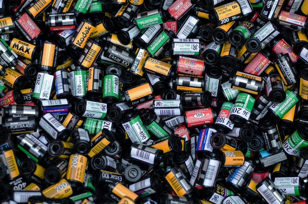 a pile of 35mm film canisters