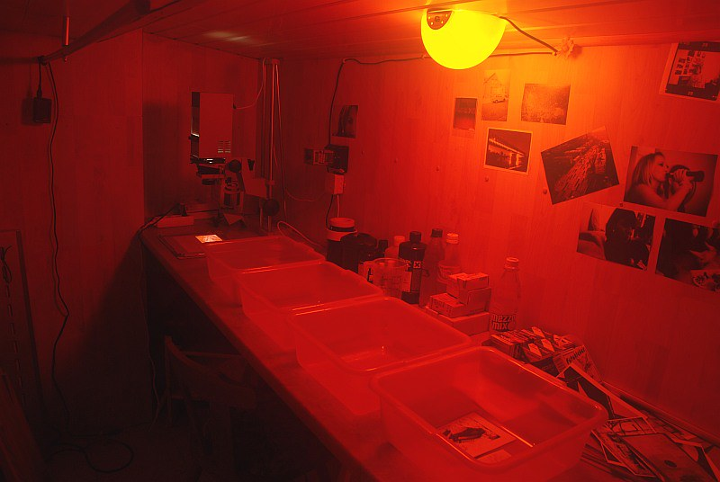A photographic darkroom with a red safelight.