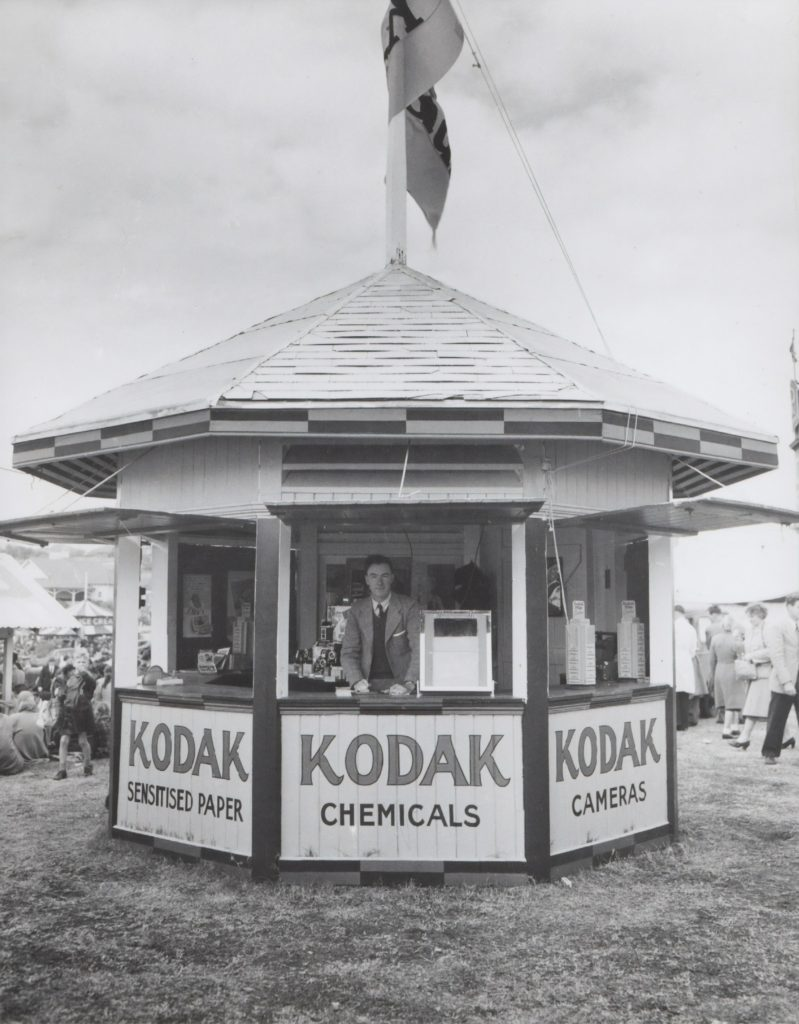 Kodak Kiosk in Australia in the 1950s where you could purchase cameras, film, or get your film developed.