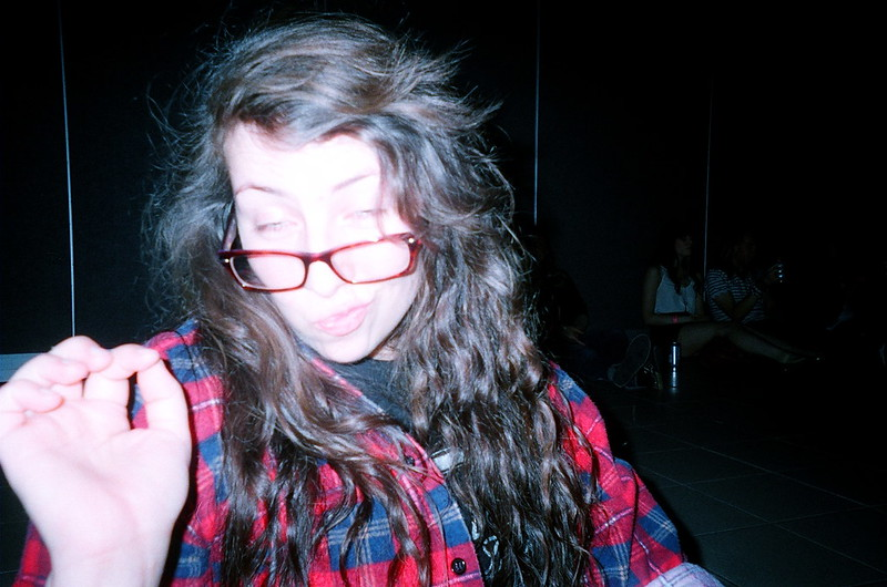 The subject was too close in this image made by a disposable camera with the flash on and is overexposed.